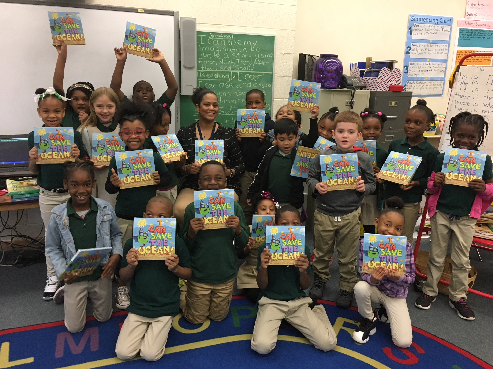 "School Class Holding Books ""I Can Save the Ocean"""